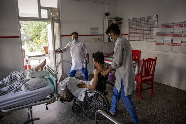 A man injured in the bombing at the Kabul airport being treated at the Emergency NGO hospital last week. The W.H.O. reported the delivery of more than 12 tons of medical supplies to Afghanistan on Monday.
